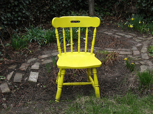 A chair painted yellow, yesterday